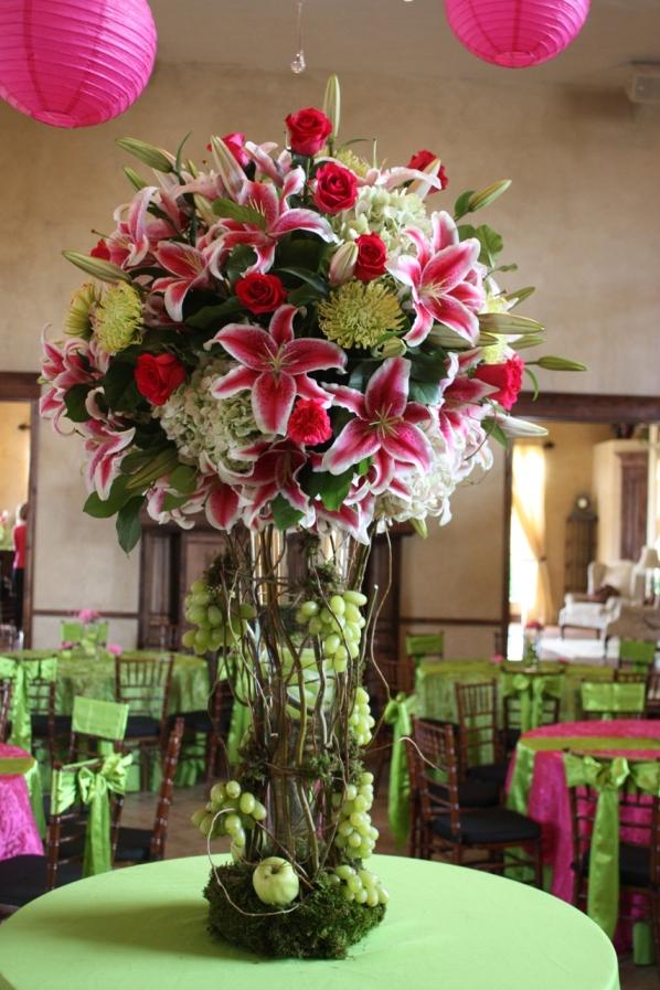 Tall wedding centerpiece with hot pink carnationsstargezer lilieshot pink