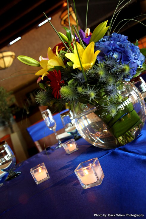 I arranged flowers as a big colourful hand tired bouquet with royal blue