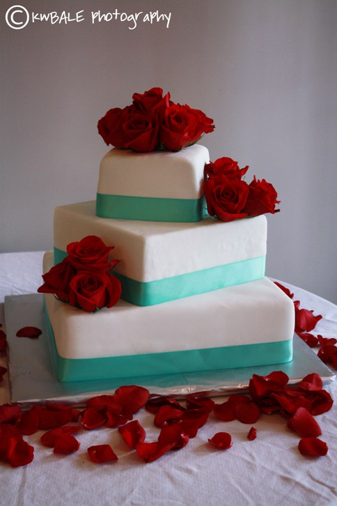 Redwhite and tiffany blue wedding cake was accented with red Roses and