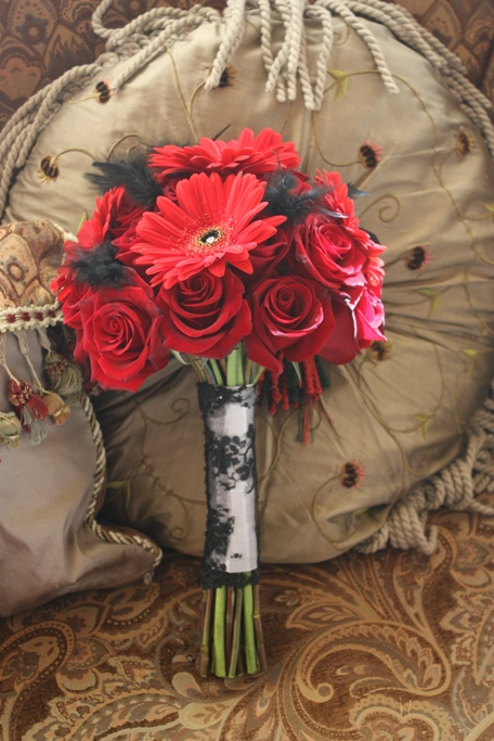 Roses and Red Gerbera bridal bouquet with black ostrich feather accent