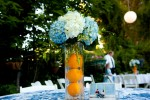 white blue and orange centerpiece for an outdoor wedding