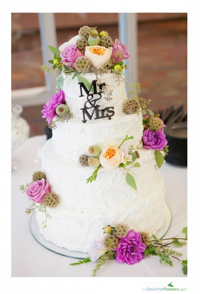 Putting Flowers Between Cake Tiers